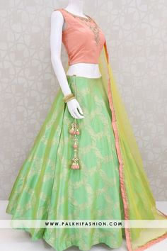 Attractive Light Green Hand worked Lehenga Set With Beautiful Colors Light green soft silk lehenga choli from palkhi fashion with peach handwork over blouse with light yellow soft net dupatta. Lehenga Choli Designs, Lehenga Designs Simple, Indian Gowns Dresses, Indian Fashion Dresses, Indian Designer Outfits, Girls Fashion Clothes, Green Color Combination Dresses, Peach Colour Combinations, Long Skirt Top Designs