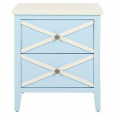 """Crafted of poplar wood and showcasing a light blue finish, this classic side table is at home in a colorful loft or cozy coastal retreat. Its timeless silhouette and latticed details add visual intrigue, while 2 drawers offer ample space to stow magazines, remotes, and more.      Product: Side tableConstruction Material: Poplar woodColor: Light blue and creamFeatures: Two drawersLattice detailsDimensions: 21.2"""" H x 18"""" W x 14.9"""" D"""