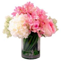 """Create a lush tablescape or charming vignette with this blooming arrangement, featuring faux hydrangea and rose blooms nestled in a glass vase.  Product: Faux floral arrangementConstruction Material: Silk, polyester, glass and acrylicColor: Pink, white and greenFeatures: Includes faux roses and hydrangeasDimensions: 12"""" H x 12"""" DiameterNote: For indoor use only"""
