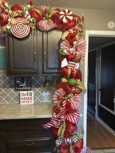Christmas Swag, Christmas Door Garland, Christmas decorations, elf decorations AboutChristmas Gift Ideas For Grieving Family Christmas Food Ideas For Toddlers!creative christmas decor ideas - superb decorating ideas to produce a fabulous Christmas de Gingerbread Christmas Decor, Candy Land Christmas, Outside Christmas Decorations, Christmas Swags, Christmas Mantels, Christmas Door, Christmas Kitchen, Simple Christmas, Christmas Lights
