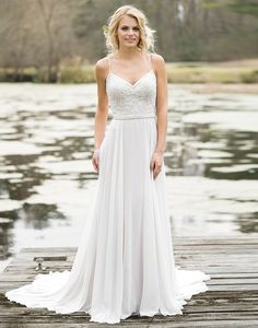 Lillian West lillian west style 6467 A beautiful combination of soft details. This lace and chiffon slim A-line gown has spaghetti straps, sequin beaded appliques, a modified V lace up back, soft chiffon skirt, and is Jersey lined.