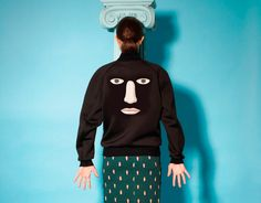 """Photographer Philippe Jarrigeon captured this surrealist editorial, featuring pieces from the collaboration between Opening Ceremony with the Artists' Rights Society. Reproductions of René Magritte's most iconic Surrealist paintings are printed on sweaters, pants, and more, giving a whole new meaning to the term """"wearable art."""""""