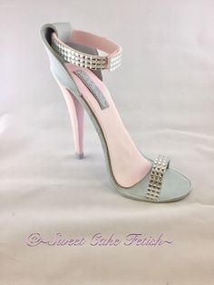 "This stunning handmade gum paste high heel, adds an elegant sass and flair to any cake. This high heel topper is completely created by hand with gum paste, fondant, non-edible diamonds to give her some serious bling. She stands at a striking 6"" tall and will fit beautifully on an 8"" round cake. This fabulous handmade sugar high heel cake topper is a must for any serious shoe lover!"