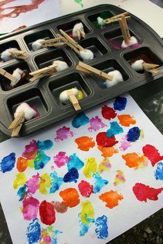 Cotton ball painting. Fun art activity for toddlers and preschoolers. Kids love getting messy! Great for fine motor skills too.