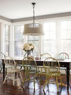 Multi-colored dining room chairs. Can choose a color? Pick them all!...need to find chairs, then Cover Store to find different pastel paints...motivated yeah