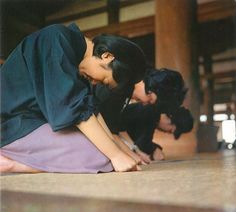 Oyasato: Holy Seat of Tenrikyo (pg 3) An old photo of followers praying in the Main sanctuary.