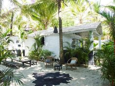 The outdoor living area and bamboo cabana of a Goa, India, beach retreat.