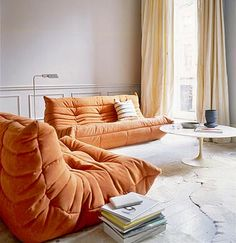 LOVE these #sofa's. they look like they'd be hard to get in and out of, but really cozy! The #orange is fab too.