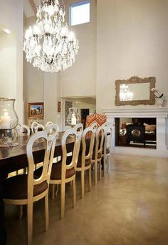 The choice of screed flooring in this dining room provides the perfect backdrop for the chandelier to stand out. Screed Floors, Concrete Floors, Flooring, South African Homes, Living Area, Living Room, Floor Design, First Home, Ground Floor