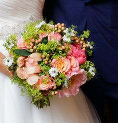 Bridal bouquet in a compact style using coral peonies, coral hypericum berries, Miss Piggy coral roses accented with limey green alchemilla and white love-in-a-mist. Coral Peonies, Coral Roses, Wedding Bouquets, Wedding Flowers, Pantone Color, Compact, Berries, Floral Wreath, Wreaths