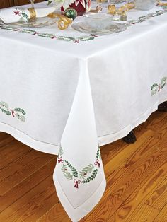 Holly Days Table Linens - Luxury Table Cloths - Let the festivities begin with elegance designed to set a new holiday tradition