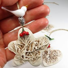 Pretty white glass dove on top of a ceramic star, Christmas tree ornament with Spruce designs