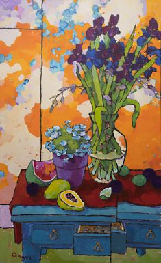 Iris and plums on blue table