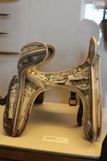 Saddle. Northern Italy, 1st half of the 15th c. Stag's horn; bone; wood; parchment . H. 385 mm x W. 365 mm x D. 470 mm. Firenze, Museo Nazionale del Bargello,  Inv. 3 A.