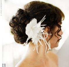 Instead of a veil, Andrea accented her updo with a feathery hairpiece dotted with Swarovski crystals. The accessory was full of vintage glamour, matching the wedding's other retro details.