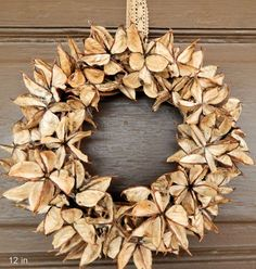 This wreath is made from the gorgeous golden cotton burrs picked in south Georgia. The cotton burr is the nest for the cotton and the interior has gorgeous natural shades of platinum gold - to tawny gold and the outside is a rich walnut brown.