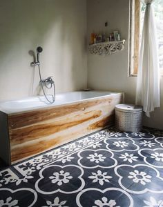 Accent: the patterned tile accents The wood around the tub