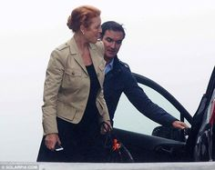 Sarah Ferguson was pictured being helped into her car by the attractive, dark-haired gentl...
