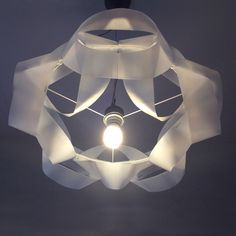 MilkChain: lampshade from milk containers by Gilbert de Rooij | Please subscribe to my weekly newsletter at upcycledzine.com ! #upcycle