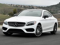 NYDN_2017-Mercedes-Benz-C300-Coupe-White-Front-Quarter-Left