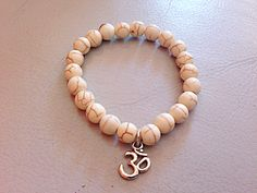 Beaded bracelet with Om charm available on Etsy at compassionatepaws      http://etsy.me/1qKwgUt