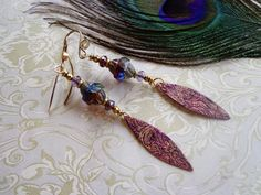 Patterned solid copper earrings by qisma @ Etsy