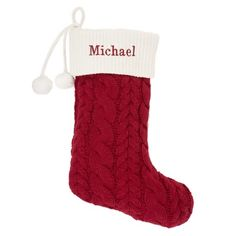 Decorate the fireplace this holiday season with our personalized Red Cable-Knit Stocking. This festive stocking features a classic red cable-knit pattern, pom-pom accents and a velvet hook for easy display over the fireplace. Embroider this stocking with a short name, monogram, or initials. https://www.thingsremembered.com/red-cable-knit-stocking/product/349356