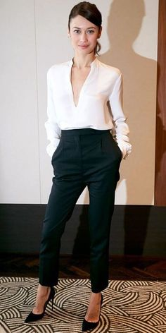 Sleek work attire. Black trousers. Black pumps. White plunging v-neck blouse