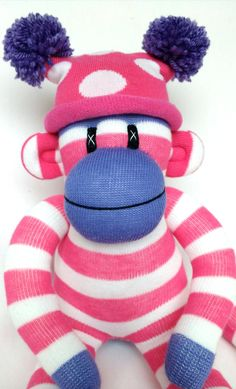 Pretty small pink and white candy stripe Sock Monkey by Sunsetgirl