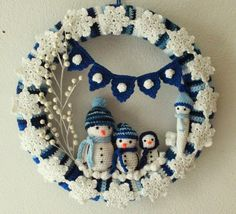 A Winter Wreath…. I've made 4 seasonal wreaths, so far. This is rather addicting, as is crochet in general. I made one for spring and summer, another one for the Fourth of July, one for the fall and finally on… Crochet Christmas Wreath, Crochet Wreath, Christmas Crochet Patterns, Crochet Snowflakes, Holiday Crochet, Christmas Knitting, Crochet Crafts, Yarn Crafts, Crochet Projects