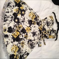 Ruby rox dress. Size 3 Yellow and black flowers on an ivory dress. Sweetheart top. Bow on the waist. Tool on the bottom. Knee length. Worn once Ruby Rox Dresses Strapless
