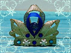 This adorable FROZEN inspired princess OR queen crown is sure to make any little girl smile. Fun for dress up time, or playing with friends, it