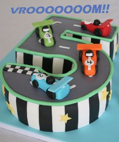 This is it, a very very cool racing car cake.  Might need to get some fondant lessons though....