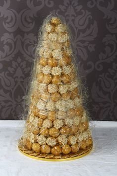 Spun Sugar Croquembouche  Also known as a pièce montée, a croquembouche is a traditional French wedding cake which has become quite fashionable in England. - http://www.lepapillonpatisserie.com/wedding-cakes/spun-sugar-croque/#