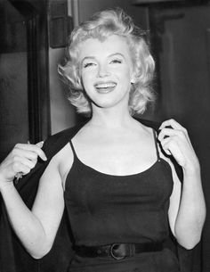 """: """" Marilyn Monroe photographed at a press conference in June 21, 1956. """""""