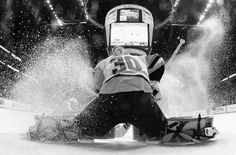 NASHVILLE, TN - JUNE 03: (EDITOR'S NOTE: Image has been converted to black and white.) Goaltender Matt Murray #30 of the Pittsburgh Penguins makes a save as ice sprays during the second period of Game Three of the 2017 NHL Stanley Cup Final against the Nashville Predators at Bridgestone Arena on June 3, 2017 in Nashville, Tennessee. (Photo by Dave Sandford/NHLI via Getty Images)