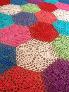 "hexagon flower crochet afghan, freebie and thanks to @Trish Papadakos Papadakos W ...The info is here: The pattern is ""Granny's Garden Hexagon"" by Cherie Durbin. She's generously shared the pattern for *free* on her website, Scrap Yarn Crochet. Here's the link ~ http://scrapyarncrochet.blo... You can also see this done by other crocheters at the Ravelry link here ~ http://www.ravelry.com/patt... Hope this is what you're looking for :-) xox"