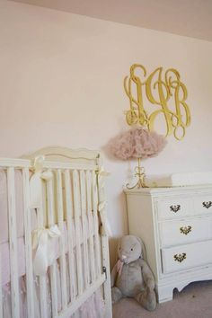 Glam pink and gold nursery. Look at the luxe wall monogram!