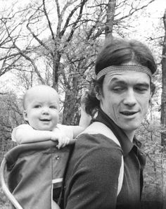 C. 1972 - my Dad is rocking the hair and the baby backpack!