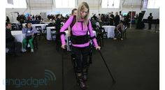 Robotic suit aids those with lower-extremity paralysis or weakness to stand, walk.