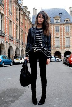 Striped tee, black trouser, black leather jacket.