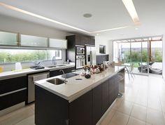 Modern kitchen with long rectangular island and slider door to garden