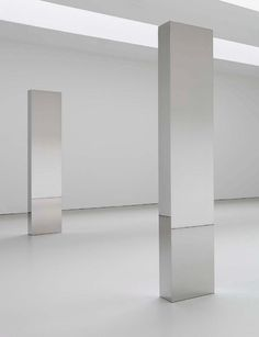 Installation view of stainless steel columns at the 2010 solo exhibition New Works in Bronze and Steel at David Zwirner, New York