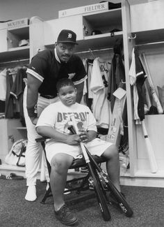 Tigers DH Cecil Fielder poses for a photo with his nine-year-old son, Prince Fielder, before the 1993 MLB All Star Game at Camden Yards. Prince must've enjoyed his father's time in Detroit because the. Detroit Sports, Detroit Tigers Baseball, Detroit Michigan, Baseball Bats, Baseball Stuff, Baseball Scoreboard, Baseball Pictures, Baseball Equipment, Sports Baseball