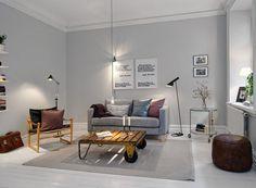 Mélange de vintage et de moderne pour la décoration de ce salon scandinave