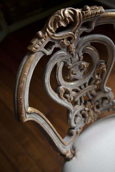 Ebanista.com.  The detail work on this chair is just my style.  #interiors