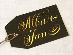 Set of 4 black card board gift tags with calligraphy in gold or bronce colored ink by Federflug, €12.00