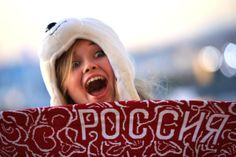 A spectator poses as she arrives for the Opening Ceremony of the Sochi 2014 Winter Olympics at Fisht Olympic Stadium on February 7, 2014 in Sochi, Russia. (Photo by Richard Heathcote/Getty Images)