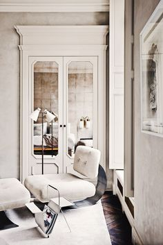 Cabinet - mirrored doors.   Like for other parts of house as well   How to Get the Maison Margiela Look At Home via @domainehome