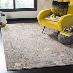 Abstract and sleek, this Meadow Collection area rug is a decor-must for softly-styled contemporary homes. Supple, easy-care synthetic yarns are power loomed into a medium cut pile, bringing comfort and warmth to hardwood and tile floors. Colored in an ivory and grey palette, this art-inspired floor covering is at once soothing and striking. #EasyCare #PowerLoomed #AreaRug #Safavieh